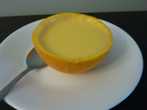 Pudding served in an orange cup.